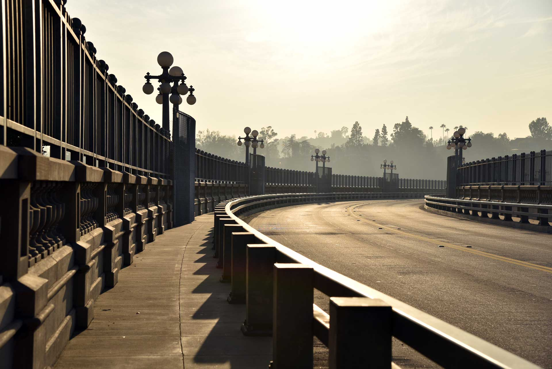 pasadena bridge in california with sun shining in the sky